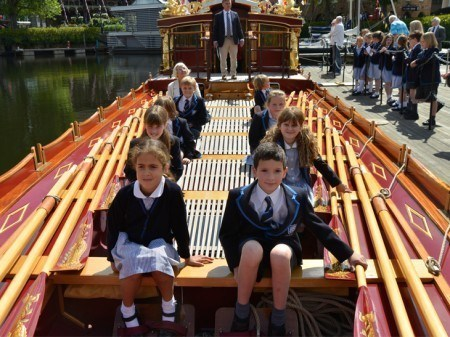 School children enjoying being on board the barge