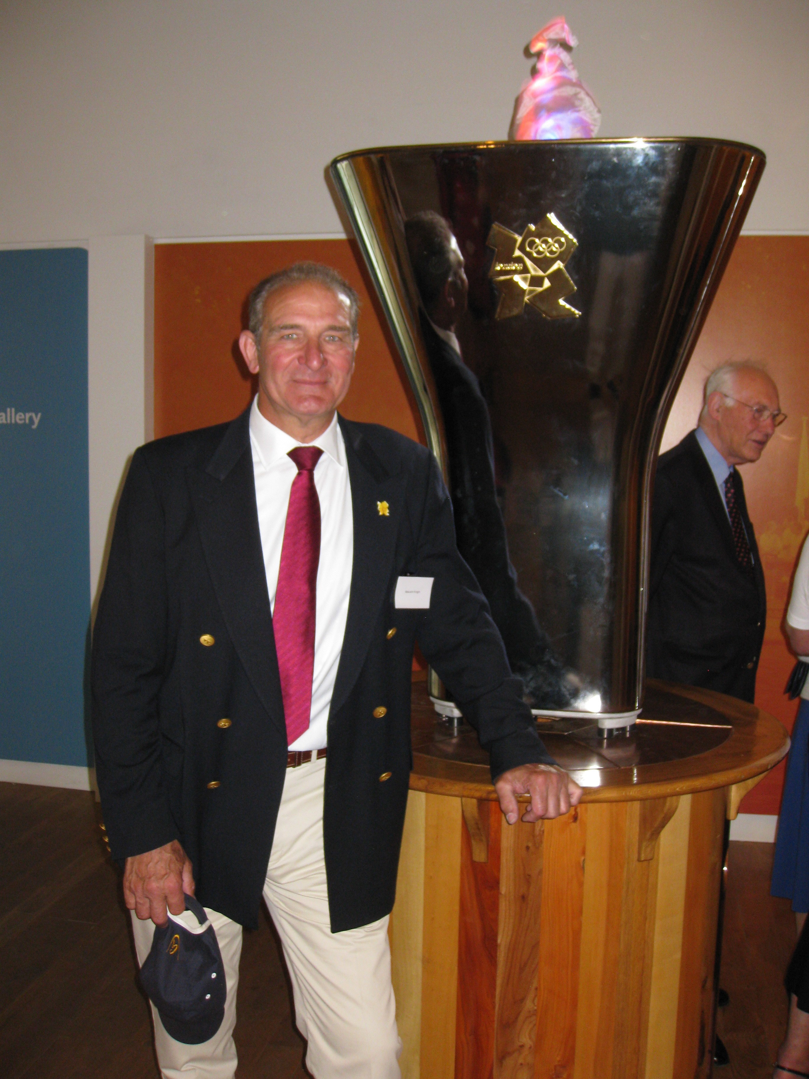 Malcolm Knight with the Olympic Cauldron in the River and Rowing Museum at Henley