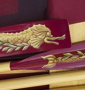 Gloriana serpent design on blades
