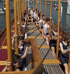 Completing their row on Gloriana at Henley Royal Regatta
