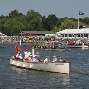 An upmire's launch seen from Gloriana at Henley Royal Regatta