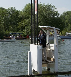 An umpire a timing station on the Henley course