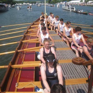 A Leander & Upper Thames mixed youth crew row Gloriana at HRR
