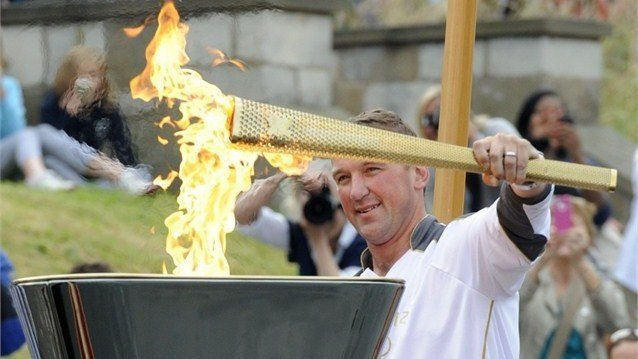Matt lights the cauldron