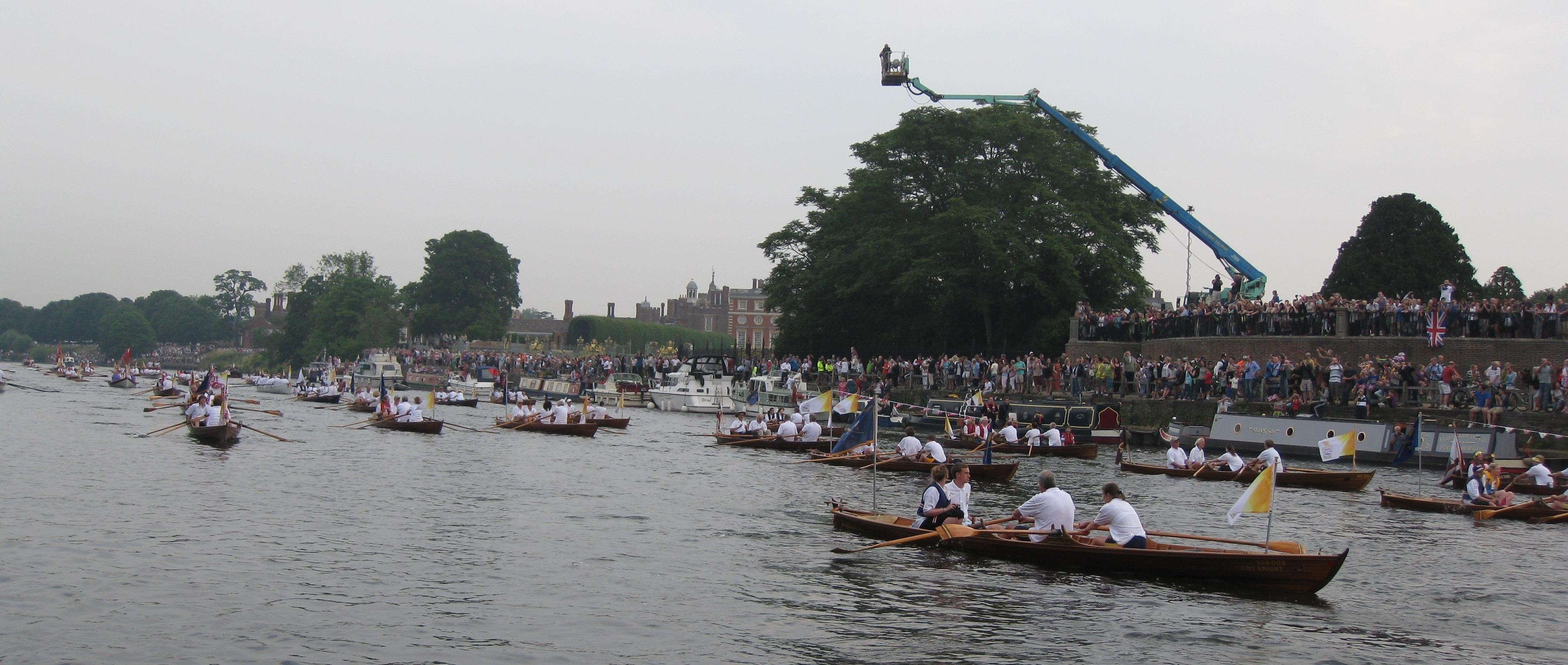 The Hampton Court Palace crowds wave goodbye