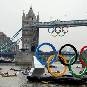 The Olympic Rings Barge and escort