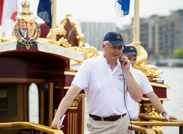 Matthew Gordon, the Cox on board the MV Gloriana as it rows up the Thames as part of HM The Queen's 90th Birthday celebrations