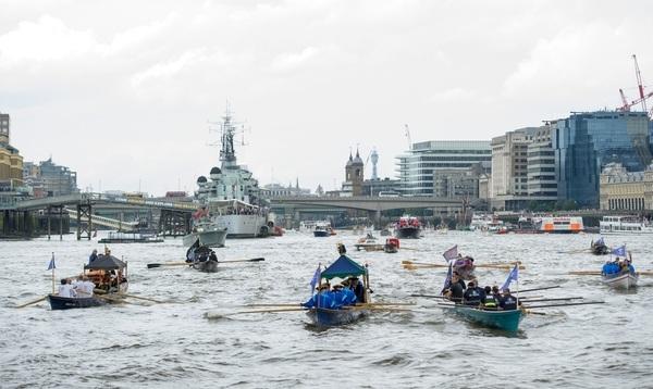 The small boat flotilla behind the Gloriana