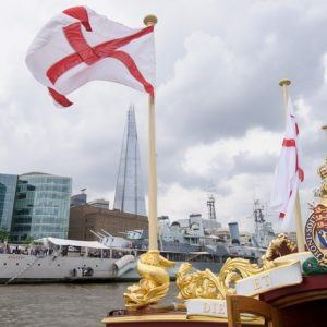 The Gloriana passes HMS Belfast MV Gloriana rows up the Thames as part of HM The Queen's 90th Birthday celbrations