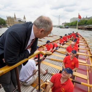 Sir Steve Redgrave talks to the crew of The Gloriana MV Gloriana rows up the Thames as part of HM The Queen's 90th Birthday celbrations