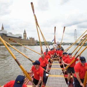 The crew of the Gloriana 'toss oars' as a salute to the Palace of Westminster MV Gloriana rows up the Thames as part of HM The Queen's 90th Birthday celbrations