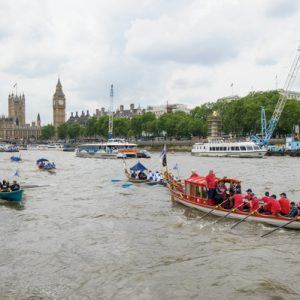 The small boat flotilla behind the Gloriana MV Gloriana rows up the Thames as part of HM The Queen's 90th Birthday celbrations