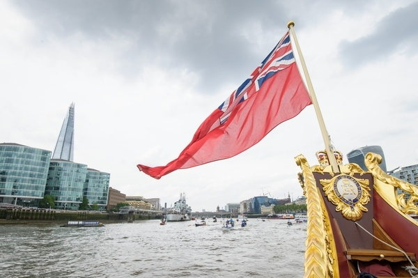 The Gloriana passes HMS Belfast