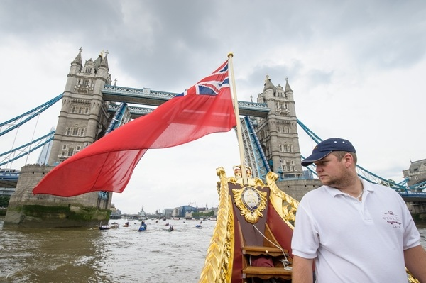 Will McKee, the Skipper on board the MV Gloriana as it rows up the Thames as part of HM The Queen's 90th Birthday celebrations