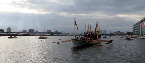 Gloriana being rowed by school children at Gloriana Achievers Day at London's Royal Docks