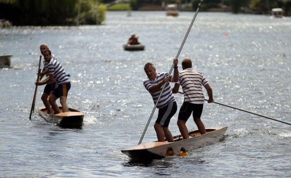 Mark Vellacott and Peter Sharp (r) take on Kit Nairne and Peter Williams (l) in the Thames Punting Club championships in Maidenhead, Berkshire PRESS ASSOCIATION Photo. Picture date: Sunday August 7, 2016. See PA story . Photo credit should read: Steve Parsons/PA Wire